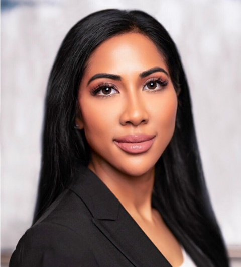 A corporate headshot of attorney Natasha Gill
